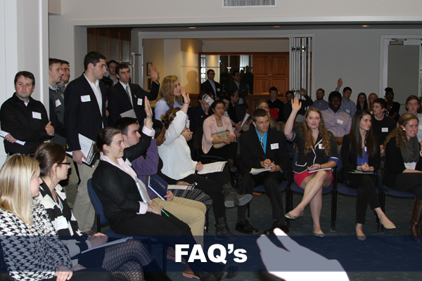 group of students raising their hands for FAQ page