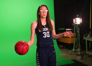 Breanna Stewart, UConn Women's Basketball player stands in front of green screen as part of a photo shoot at the NCAA Final Four Tournament.