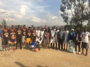 Khalil Griffith pictured with members of one of the villages in Kibera, where he visited to implement the curriculum from 'A Call to Men.'