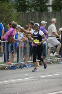 Kydani Dover running the Boston Marathon to raise money for Boston Scholars.