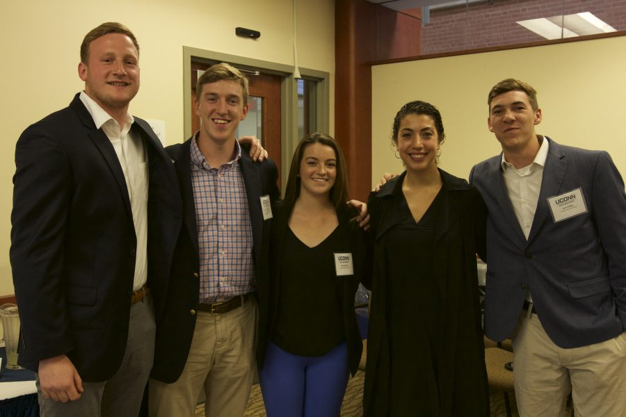 Graduating seniors in the Sport Management Program participated in a special ceremony to recognize and celebrate their graduation. The event wsa held in Gentry 144 on April 26, 2017. Pictured: Bucky Gumbrewicz, Tyler Axon, Sofia Read, Chelsea Zabel