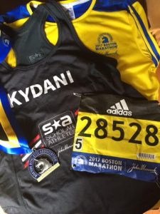 Kydani Dover's Boston Marathon apparel - shirt, jacket, number, marathon patch.