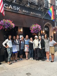Sport Management alumni gather together for a Happy Hour event in front of Cask Restaurant in NYC.