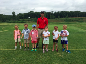 Kyle Caron at his internship this summer during golf lessons.