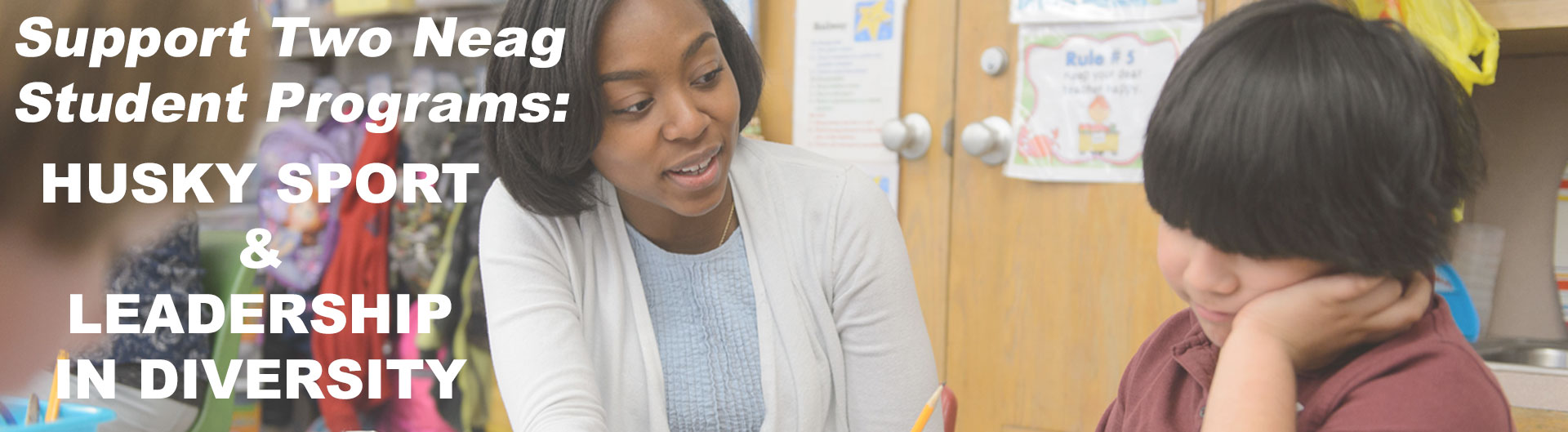 Symone James reading with a student