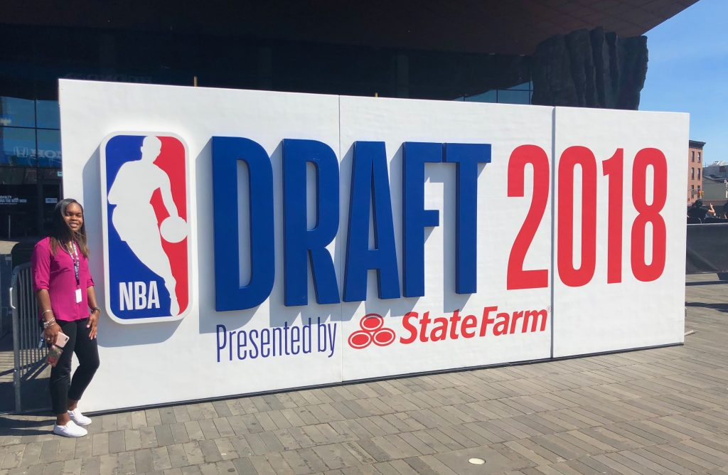 Autumnsarah Foster-Pagett in front of the DRAFT 2018 sign