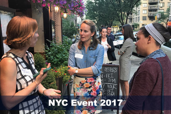 Jennie McGarry converses with two SMP alumni at NYC alumni event in 2017.