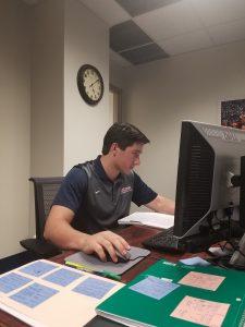 Walker Hill at a desk