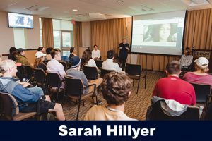 Sarah Hillyer speaking in front of students in Gentry, fall 2018